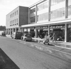 Great picture of the old fashioned prams, scooter and cars outside East Kilbride Shopping Centre.