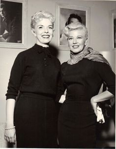 Ginger Rogers poses with Marlys Pearson at the Rivera Hotel in Las Vegas. Miss Pearson is a dancer in a show in Vegas. Ginger appears to be younger than Miss Pearson but she is actually twice her age at 46. March 7, 1958