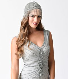 Shimmy and sway in beaded bliss! Presenting a gorgeous, intricately beaded flapper style cap in classic silver. A secure mesh provides the foundation for lattice beading that flows into fabulous fringe. Cap off your 20's ensemble like the best of them! <b