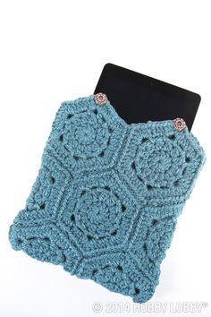 Tucking your tablet in for the night? It'll have sweet dreams in a cushy crocheted storage sleeve. Ours features ten simple granny hexagons, all in a solid shade of soothing blue. Design idea: decorative buttons (choose your favorites) at the points.