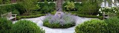 Formal garden designed by a local landscape architect and installed by JW Townsend.