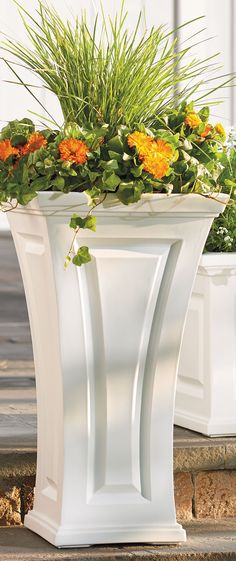 Our Cambridge Tall Planter is so care-free you'll never reach for a paintbrush again. Frame your front door with these curvy planters