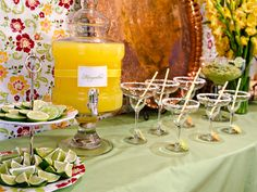 Margaritas have never looked more enticing or thirst-quenching than in this epic drink display. We love the margarita glasses with salted rims and the array of limes, a margarita must!