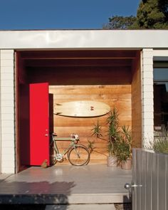 malibu beach house front entry with red lacquer door. love.