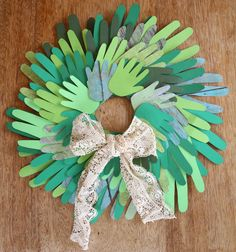 Trace, place, glue, and hang. Make a holiday handprint wreath.
