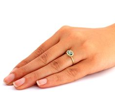 ✿ DESCRIPTION  A handmade solid 14k gold ring set with a natural emerald stone.  This ring is a dazzling, solitaire sapphire ring. The emerald gem is set in an open bezel exposing the emerald to more light and increasing its intensity.  The ring was designed with the bezel sitting on top of the ring allowing you to wear it on its own or to stack it with other rings.   THE RING  Made from solid 14k gold, 1.3mm round wire. The ring in the photos has a Stardust finish. A polished or matte…