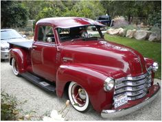 Gorgeous maroon 49'-51' Chevy 3100 with windshield visor on baby moons