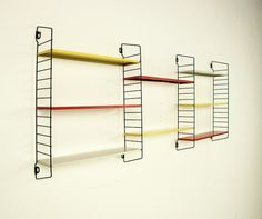http://www.design-market.fr/5332-%C3%A9tag%C3%A8res-modulables-rouges-blanches-et-jaunes-adrian-dekker-ann%C3%A9es-50.html