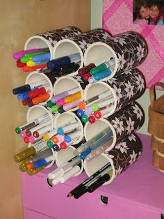 PVC pipes turned into arts and craft organizers. This would be so useful while actively drawing. Much easier to find the right color.
