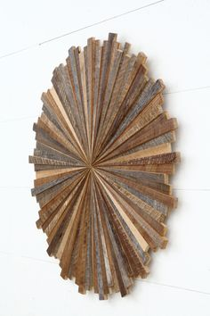Starburst wood wall art made with old reclaimed by CarpenterCraig