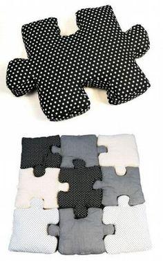 Не было бы отличная идея, чтобы иметь картину, напечатанный на большой кусок ткани, вырезать его в формы головоломки, и положил его вместе ?: