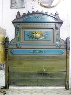 Amazing handpainted old bed.   I do not know if I can paint florals, but I sure can print, cut and decoupage some gorgemousness on a painted bed and call it it!!