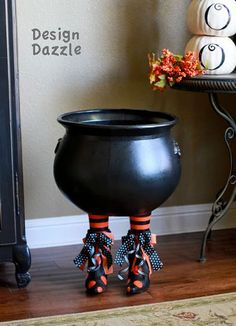 How to make a witch's cauldron using old boots/shoes...they even show how to use the same concept for a cake stand.