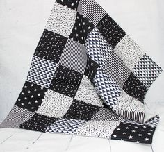 Black & White Nursery, Baby Blanket, Baby Bedding , Baby Quilt, Modern Patchwork Quilt , Monochrome Nursery, Baby Blanket, Home and Living, Quilts  Baby blanket in a modern style. Interior detail for the nursery or kids bedding room , delicate and full of charm.  A great baby shower gift! In a harmony of colors baby Black and White and graphic design, it will suit both girls and boys.  Patchwork cover made of cotton with thick padding, can very well be used as a play mat.  It can also be...