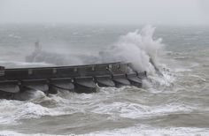 Waves crash over the marina wall in Brighton, East Sussex