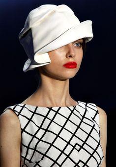 Cute hat with asymmetrical brim.