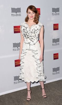 Emma Stone | An arch yet twisted glamour ruled the red carpet and the front row, enlivened with feathers, florals, and ruthlessly chic ruffles.