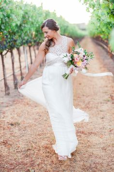 Unique jeweled halter wedding dress: http://www.stylemepretty.com/california-weddings/geyserville-california/2016/01/17/french-inspired-wine-country-wedding-at-geyserville-inn/ | Photography: Lori Photo - http://loriphoto.com/
