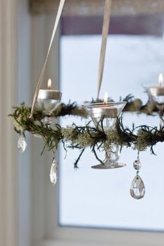 how simple and serene is this...wine goblets with votives encompassed with greenery and crystal drops