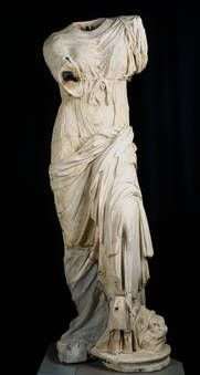 A Roman copy of a Hellenistic original. Stripped of the baroque additions that distorted it, it is part of a large cycle of Venuses linked by similar postures.  The beginning of this type of sculpture would seem to lie in a work by Lysipus or his school known through a Roman copy: the Venus of Capua. In it, the goddess, with a nude torso, looks at her reflection in Ares' shield, which she holds in both hands. Museo del Prado