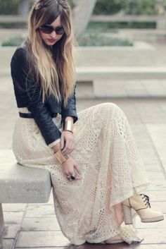 Leather jacket, lace maxi, platform heels, and gold cuffs.