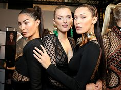 Star Tracks: Monday, October 5, 2015 | BALLIN' IN BALMAIN  | Models Lily Aldridge, Lily Donaldson and Bella Hadid strike a pose backstage at the Balmain show during Paris Fashion Week on Thursday.