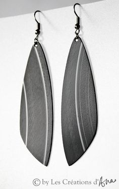 long earrings. black earrings. recycled vinyl record. eco friendly. modern recycled jewelry. minimalist jewelry. limited edition.. $14.00, via Etsy.