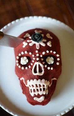 Create your own red velvet Dia de los Muertos cake! This is a fun Halloween treat for kids & adults.