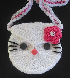 "This adorable Pink Hello Kitty purse is perfect for the little ""Hello Kitty"" Princess! Little crocheted purse is adorned with a pink flower and a 'Hello Kitty"" charm. Purse has cute black button eyes and an a pink button nose."