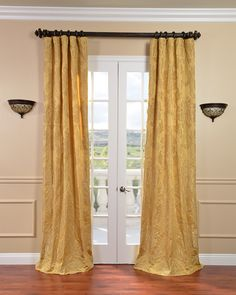 Your home will look extremely sophisticated with these stunning faux-silk Jacquard curtains over your window. The textured finish and golden color of these curtains gives them a grace and elegance that works well with traditional decor.