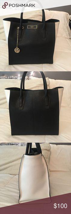 DKNY Handbag Used good condition handbag saffiano leather black and white bag. Comes with dust bag Dkny Bags Totes