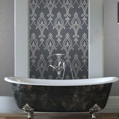 An intriguing and beautiful nouveau damask wallpaper with a contemporary twist. Burnished silk metallics and a glitter dusted texture add glamour to this curvaceous design. Gravure, screen printing and embossed printing techniques give the charcoal grey design a high fashion finish.
