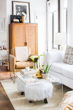 1960's inspired living room with mod whites, and an acrylic coffee table.