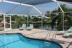 Contact us for more information! This huge 2400 sqft. Pool Home is located on an intersection canal; very nice neighborhood, close to shopping, restaurants and beaches. #capecoral #vacation #paradise #florida #swfl #vacationrental #dreamvacation