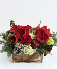 Fireside A stunning collection of reds and whites - including amaryllis, roses and hydrangea - is accented with seasonal greens in our rectangular glass vase lined with a strip of white birch bark.