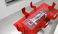 Astrolab glass extension table has integrated leaves and an exposed system of…
