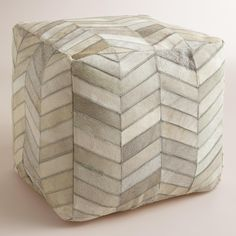 With a modern pattern, our exclusive pouf  is crafted in India of all-natural cowhide. This comfy cushion is ideal for distinguishing small spaces or adding an extra seat for guests without taking up too much floor space.