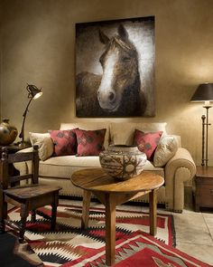 Red and neutral southwestern living room with large horse art!