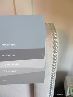 Side-by-side comparison of Behr Atmospheric, Behr Pier, Behr Fashion Gray, Behr Classic Silver, Behr Antique Tin