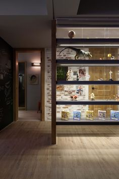 The Family Playground by House Design (12)  | display shelves for the library