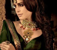 Vintage designs in jewellery can have a royal look. In India, vintage designs get inspiration from Moghul era. The queens of those days use to wear those artistic and Jadau jewellery which is very much liked now. Such items may also carry Jaali and Kundan karigari to give it a refresing appearance. Every bride of today has a dream to wear Moghul style of jewels which are at times available from her mother/granny's cupboard.