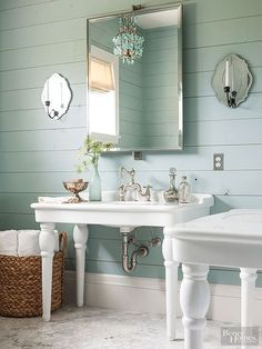 Who needs a double-sink vanity when you can opt for expansive pedestal sinks that provide era-apt profiles and ample counter space? In addition to elegant sinks, this bathroom presents vintage design ideas in fresh ways. Sea-glass-green paint on horizontally set boards creates a beachy backdrop that highlights mirrored sconces and faucets with vintage silhouettes. A prismatic chandelier contributes flashes of sparkle.
