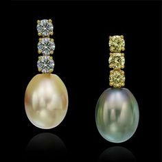 Golden and Tahitian pearl pendants hang from gray and yellow diamonds in these delightful earrings set in 18k yellow gold.