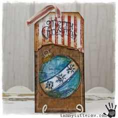 Tammy Tutterow | Merry Christmas Ornament Tag featuring Tim Holtz Stamps