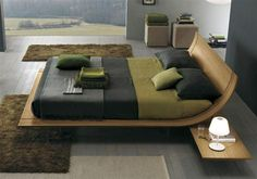 This modern bed design from Usona is similar to the Grecian Kline, a bed and reclining couch. The shape is the same but simplified with the traditional legs and volute being shrunken to the point where they are not seen.