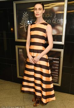 Wow factor:Erin O'Connor was another catwalk beauty who checked out the screening, looking simply stunning in a gold and black striped dress which accentuated her svelte figure
