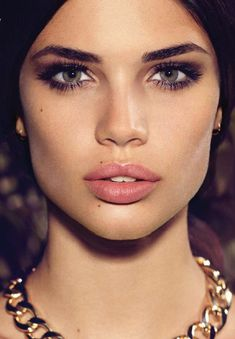 Love this, strong brow, satin skin, full lashes and natural lip...looks glam and youthful