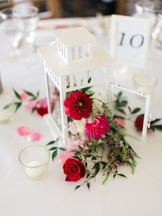 Melissa & Steven Sydney wedding | Reception table centerpiece - asian australian fusion theme with white lantern and flowers spilling out of it - roses, pittosporum, carnations, baby's breath, waxflower + tea lights - Flowers by Lime Tree Bower | Photo by We Are Origami | Location at Manly Golf Club