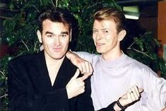 Does Bowie not understand the pure joy that enters our hearts when we see a photo like THIS?   Morrissey And David Bowie AreFighting