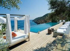 Four Amazing Greece Villas Design With Breathtaking Scenery: villa eudokia greece with luxury white daybed canopy and outdoor patio with inf...